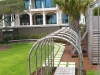 Kiawah_custom metal arbor tunnel with misters in backyard