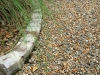 Livingston_soldier brick border in gravel driveway with native grass