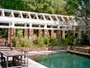 paris mountain_greenville_south carolina_pool with arbor and stone retaining wall_native grasses