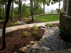 paris mountain_greenville_south carolina_rock swale with stone walkway through plant bed