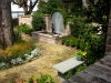 Shedlarz_courtyard garden with brick fountain and bench.jpg
