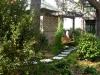 Shedlarz_swing with tabby and mondo grass walkway.jpg